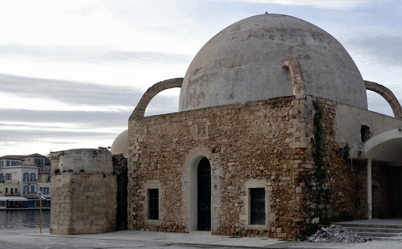 Mosque of Kioutsouk Hasan, Chania, Crete, 24 December 2009 1.     The only surviving mosque built during the Turkish occupation.  At left is the base of its minaret, demolished in the late 19th century.
