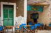 Restaurant with tables and chairs in Kardamyli, Pelpoponnese, Greece.