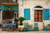 Restaurant with tables and chairs in Kardamyli, Peloponnese, Greece.
