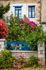 Bougainvillea and a variety of spring flowers adorn the fences, gates and yards of homes in Kardamyli, Peloponnese, Greece.