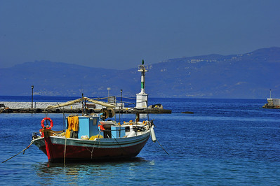 Greek fishing boat anchored in the harbor