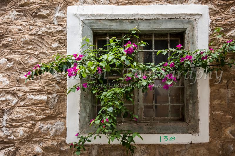 Attractive shutters, doors and windows of Nafplio, Greece.