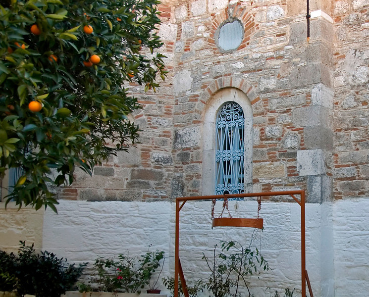 Orange tree and bell, Agias Triadas (Holy Trinity) Monastery, near Mytilini, Samos, Greece, 31 December 2008
