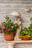 Greek decor of pots, urns and flowers at the Kalamata Hotel and Resort on Kalamata Beach, Greece.
