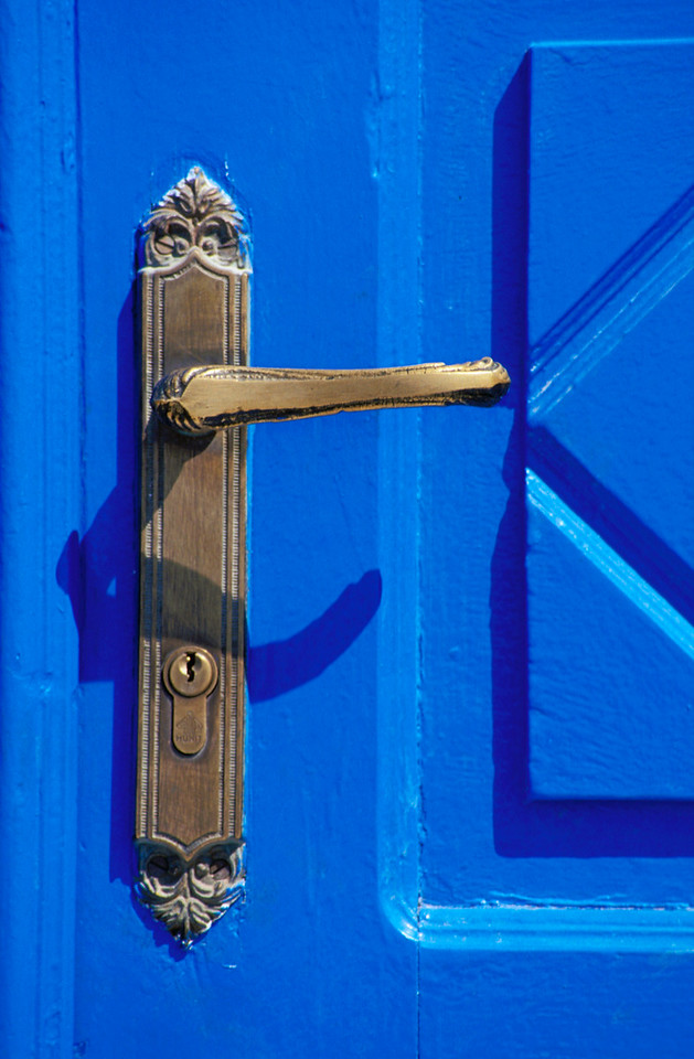 Copper Handle of Closed Blue Door