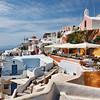 Hillside view of colorful restaurant in Santorini