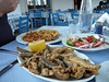 """The waiter called these """"small fish.""""  They could be deep fried anything: sardines?  minnows? bait?  They were crunchy and good (heads, tails, and all), but too much for me.  I fed the cat who materialized under my chair.  Peter's calimari were too tough to eat."""