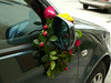 On May Day, it is the custom to hang floral wreaths on houses and cars.  This one was particularly nice.