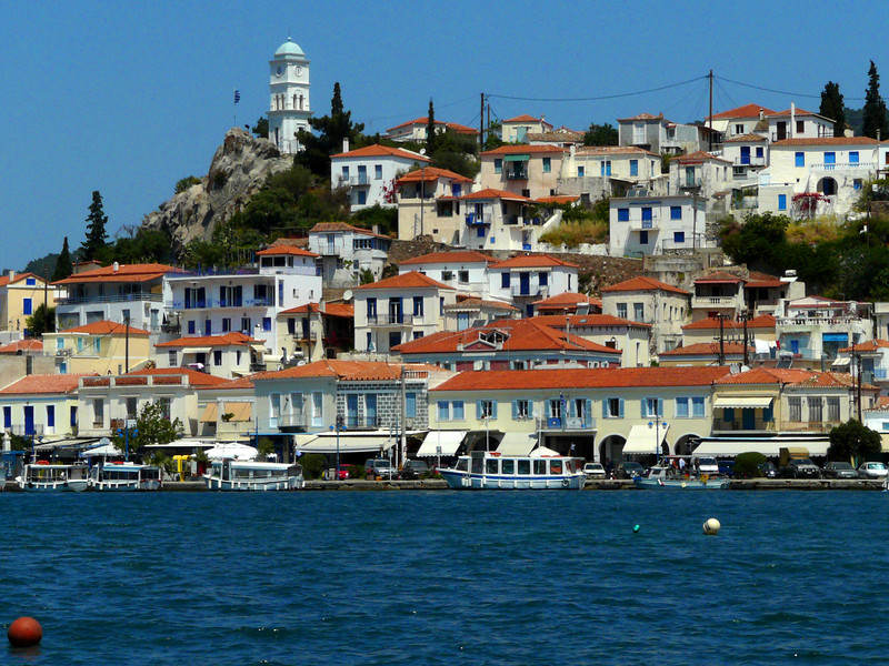 Poros, with its clock tower.  Poros is only a few hundred yards from Galatas on the mainland.  Those are water taxis in the foreground.