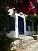 Blue Doors on Hydra, stunning with bougainvillea.