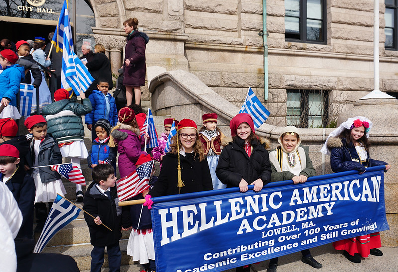 Briana Hardy, Zoe Jackson, Giah Saldarriaga, Ava Regan hold Hellenic American Academy banner on the steps of City Hall during Greek Independence day celebration. (The Sun / Chris Tierney)