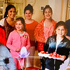 The Z-List's goddaughter, Despena Zouzas, holds red Easter eggs with her sister Sophia and cousins.