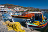 Colorful fishing boats in the harbour of the seaside village of Elounda, Crete, Greece.