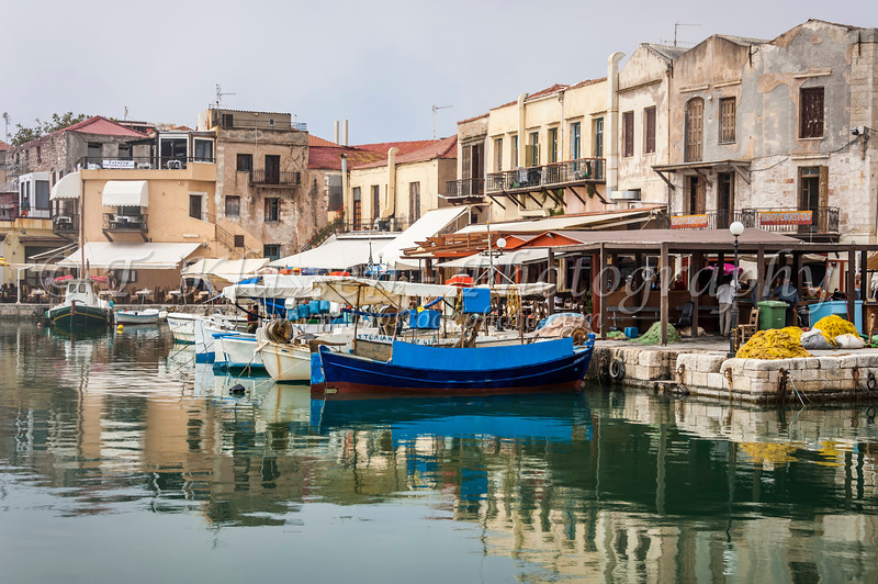 The Venetian harbour with colorful fishing boats in Rethymno, Crete, Greece.