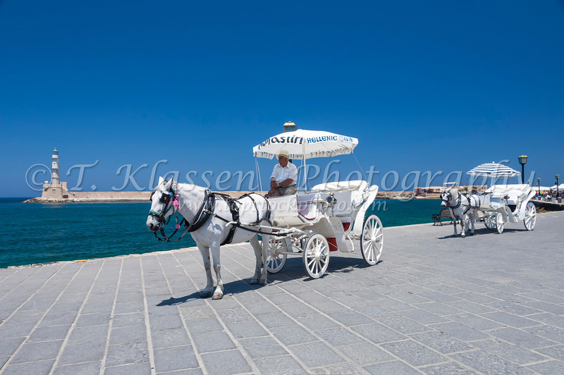 Horse and carriages line up at the waterfront of Hania on the Greek island of Crete.