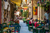 Colorful outdoor restaurants in the narrow alleys and streets of Hania on the Greek island of Crete.