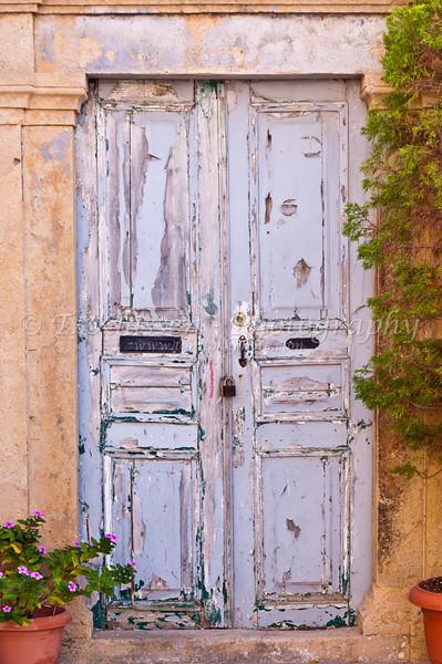 Doors to various buildings on the Greek island of Patmos.