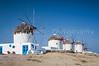 A row of windmills in Hora on the Greek Island of Mykonos, Greece.