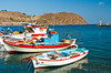Colorful fishing boats in the harbor at Skala, Greek island of Patmos.