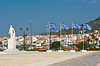 A small plaza with Greek flags on the harborfront of Vathy, Samos, Greece.