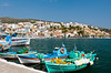 The picturesque harbor with colorful boats at Pythagoreio, Samos, Greece.
