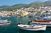 The picturesque harbor with colorful boats at Vathy, Samos, Greece.