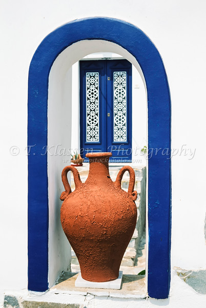 Greek Mediterranean decor of arches and pots along the streets in Fira, Santorini, Greece.