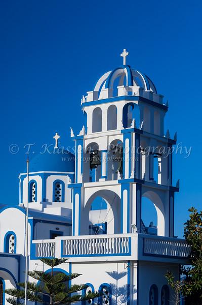 A large blue domed church near the village of Kamari on the Greek Island of Santorini, Greece.