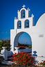 A traditional greek church near Amoudi Bay on the Greek Island of Santorini, Greece.