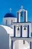 A traditional Greek blue domed church near Pyrgos on the Greek Island of Santorini, Greece.
