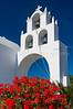 A traditional white church in rural Santorini near Fira, Greece.