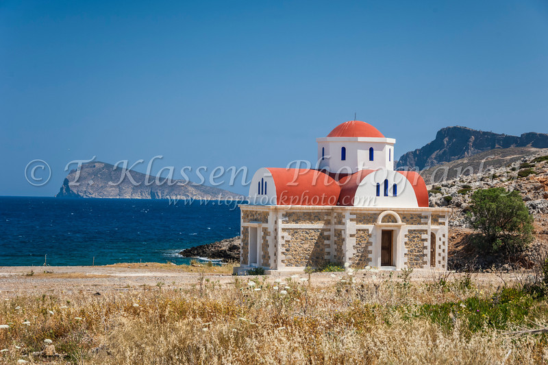 A small Greek Orthodox church along the shores of Mirambelou Gulf in eastern Crete, Greece.