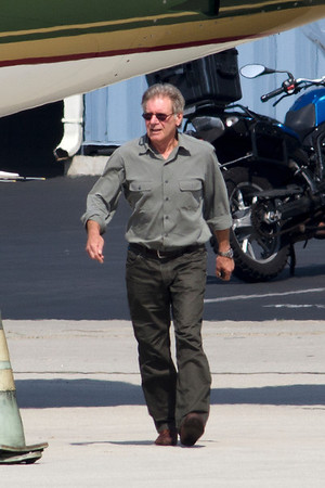 Green Harrison Ford with his new Tesla and his jet