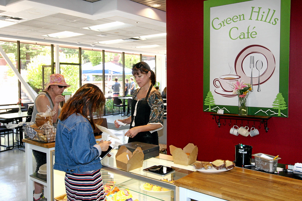 . Green Hills Cafe co-owner Heidi Johnston helps customers at Green Hills Cafe in Scotts Valley.  (Dan Coyro -- Santa Cruz Sentinel)