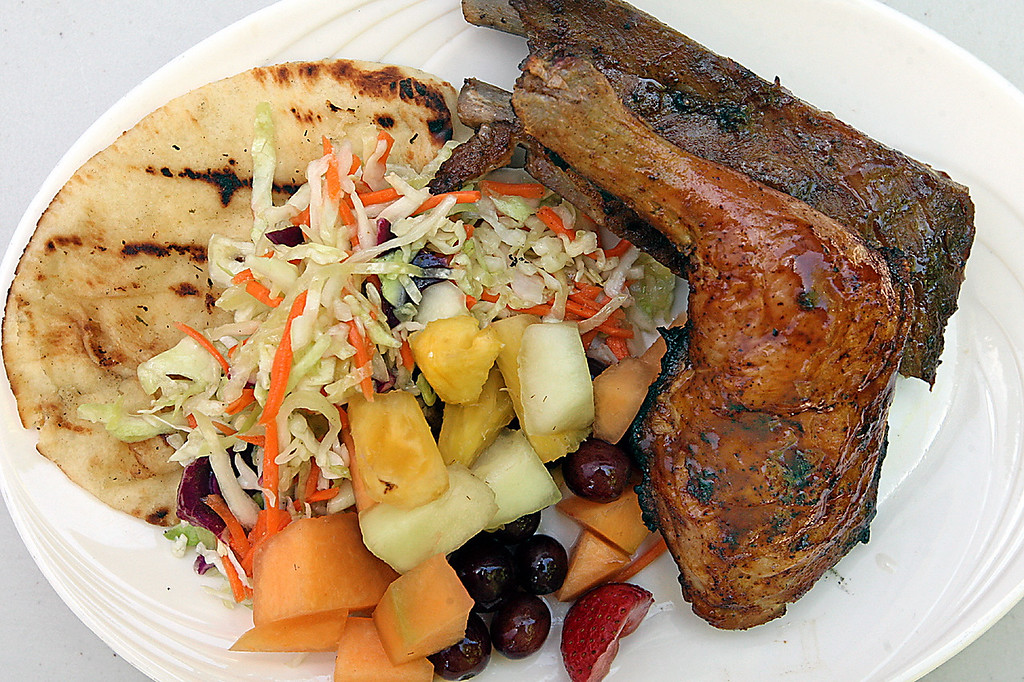 . Barbecue chicken and two spare robs are sided by slaw, fruit salad and nan bread at the Green Hills Cafe.  (Dan Coyro -- Santa Cruz Sentinel)