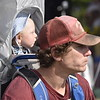 GREG SUKIENNIK -- MANCHESTER JOURNAL<br /> A father carries his child across the grounds at Hunter Park during the Green Mountain Bluegrass & Roots Festival in Manchester on Saturday.