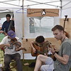 GREG SUKIENNIK -- MANCHESTER JOURNAL<br /> An impromptu jam session broke out at the Muleskinner Instruments vendor tent during the Green Mountain Bluegrass & Roots Festival on Saturday.