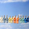 baby concept:colorful baby booties hanging on a clothes line