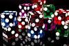 8389439-colorful-las-vegas-gaming-dice-on-a-black-background