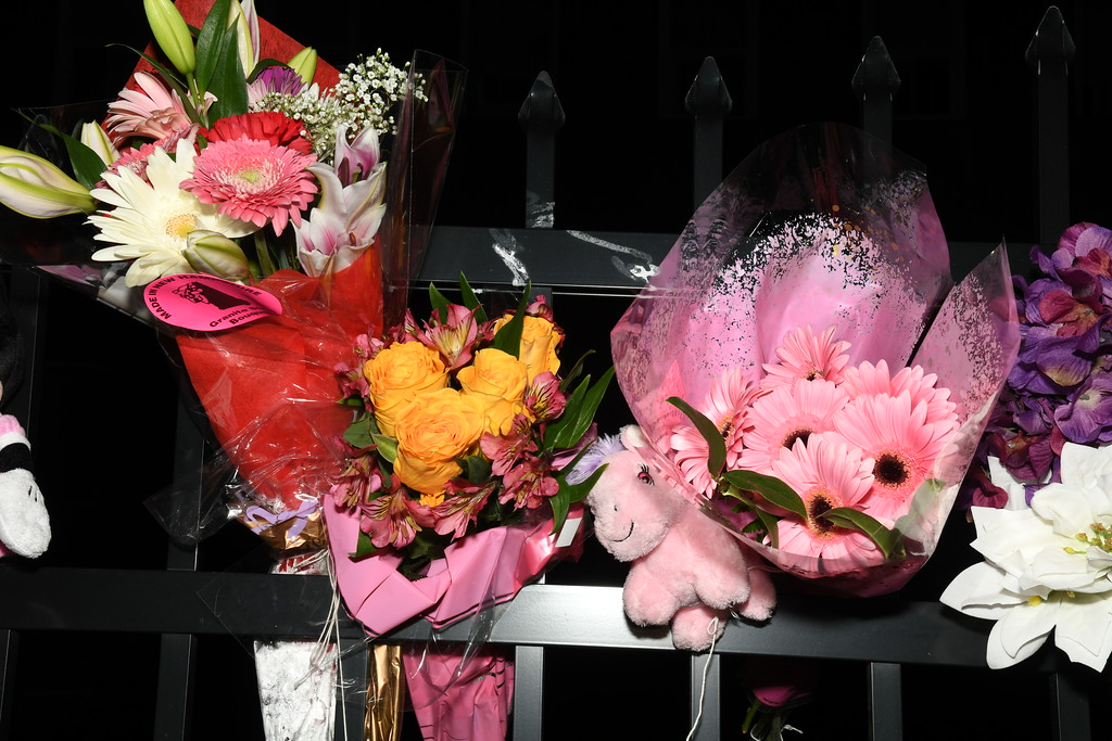 . Flowers and a pink Pony adorn the fence outside the Willow Loft Apartments in Fitchburg. Sentinel & Enterprise / Jim Fay