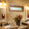 The master bath includes his and hers sinks and mirrors.