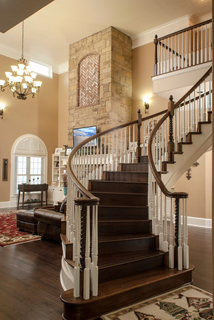 The sweeping stair separates the entry of the Inhofe home from the living room. The great room is spacious, with a 21-foot-high ceiling.