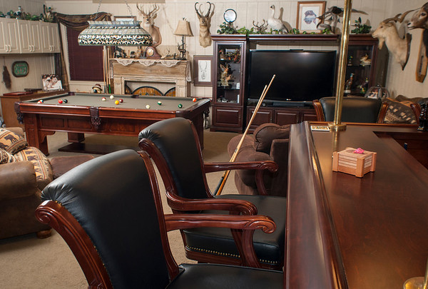 The Garretts have created a man cave/guest house with all the appointments, including a bar and pool table, on their ranch.