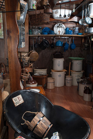 A variety of household items, including an old-style bathtub, are offered at the mercantile.