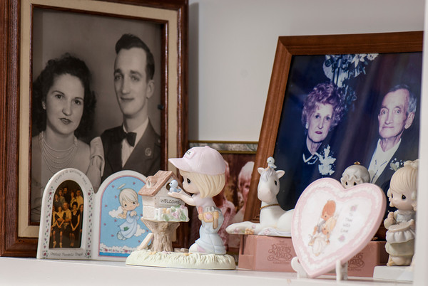 Precious Moments collectibles surround family photos in the Humphrey home.