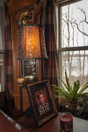 Warm tones, plants and family photos give the Wright home a homey appeal.