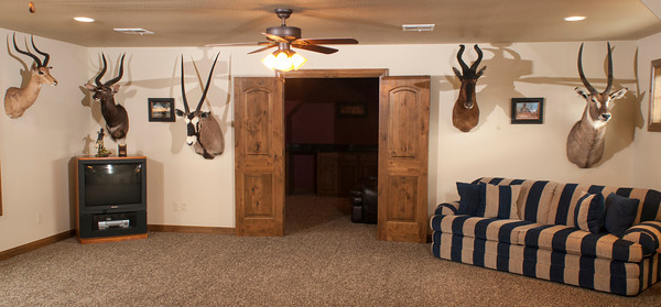 Caleb Harris traveled on safari to Namibia and Zimbabwe to bring back these trophies for his game room.