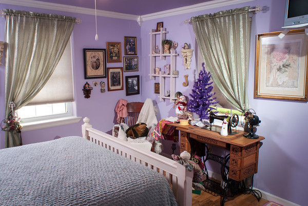 Family heirlooms are on display in the lavender guestroom.