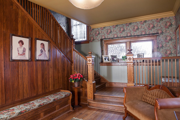 Family portraits adorn the staircase in Steve and Julie Grober's carefully restored home.