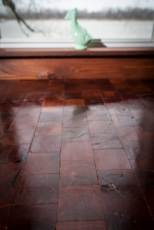 The wooden floor is made of individual squares of mesquite wood. Danny Haley says it is the world's third-hardest wood.